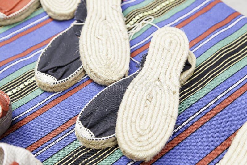 Handmade espadrilles esparto. Espadrilles Esparto craft, detail of handmade slippers stock photos