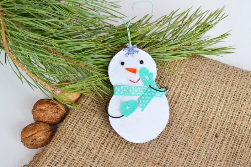Handmade felt Christmas snowman toy. Felt decoration. Felt Christmas ornaments. Felt Christmas ornaments ideas. Christmas tree ornament. Felt crafts. Christmas royalty free stock photo