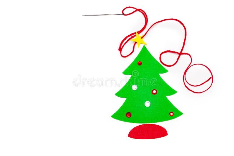 Handmade felt Christmas tree, needle and cotton royalty free stock photos