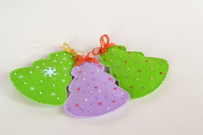 Handmade felt Christmas trees. Handmade kids crafts. Christmas decorations. Felt Christmas ornaments. Felt Christmas ornaments ideas. Christmas tree ornament royalty free stock photo