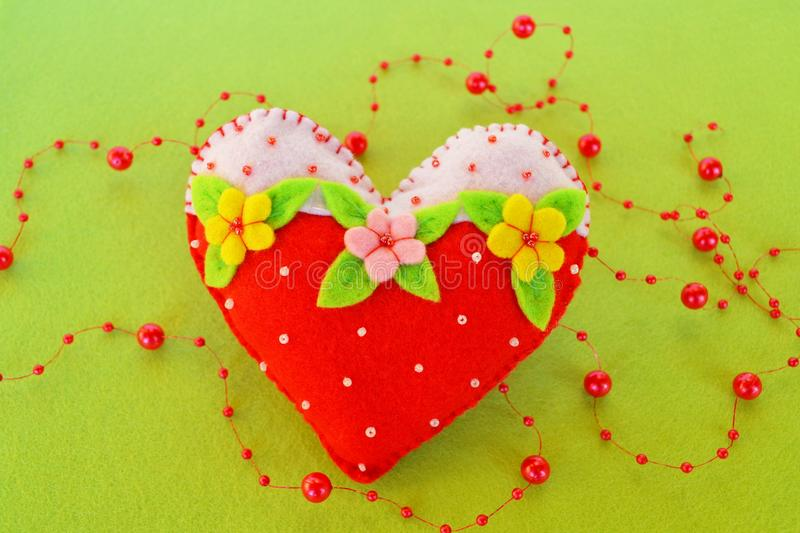 Handmade felt heart - symbol of Valentines Day, beautiful heart handmade. Valentines day crafts. Valentines day homemade crafts. Valentine crafts for adults royalty free stock images