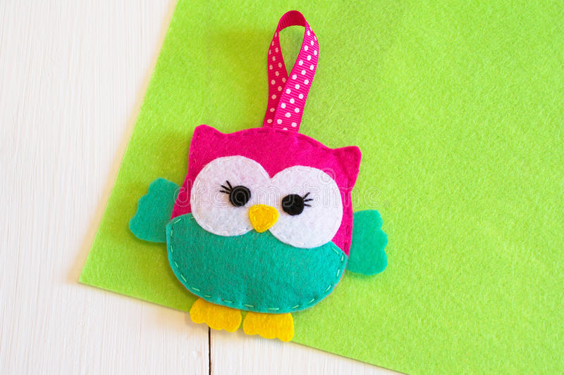 Handmade felt owl toy - how to make an owl toy. Felt owl sewing. Stuffed owl tutorial. Felted miniature animal. Felt animals. Handmade felt owl toy. Miniature stock images