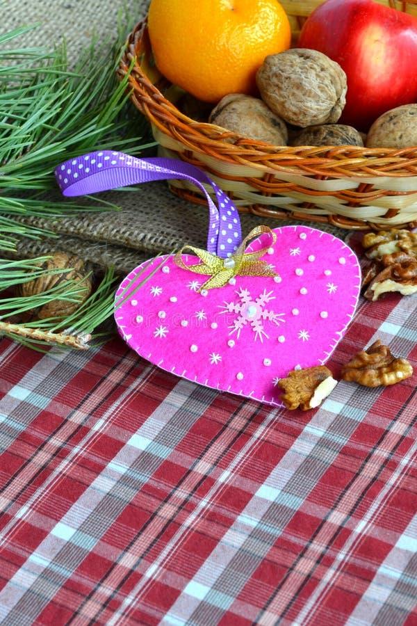 Handmade felt Valentine`s day heart. Kids craft stock photo