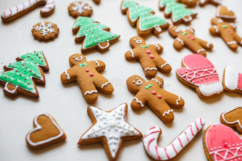 Handmade festive gingerbread cookies in the form of stars, snowflakes, people, socks, staff, mittens, Christmas trees, hearts for. Xmas and new year holiday on stock images