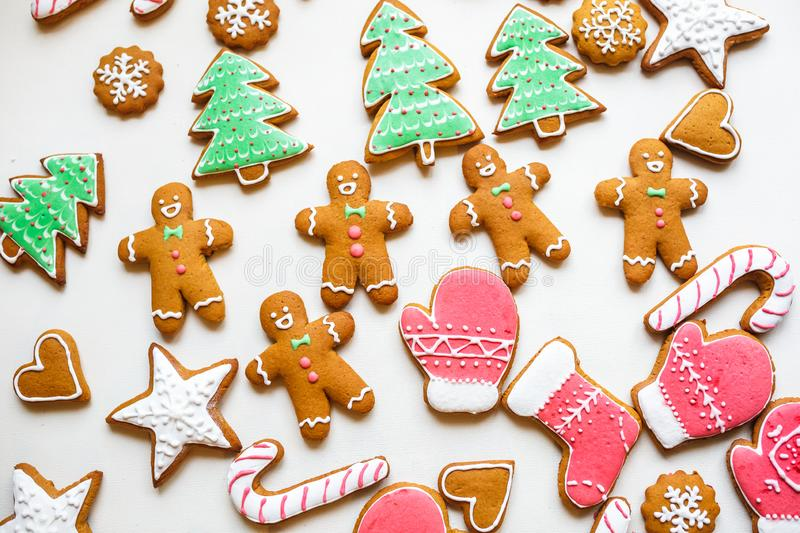 Handmade festive gingerbread cookies in the form of stars, snowflakes, people, socks, staff, mittens, Christmas trees, hearts for. Xmas and new year holiday on royalty free stock photo