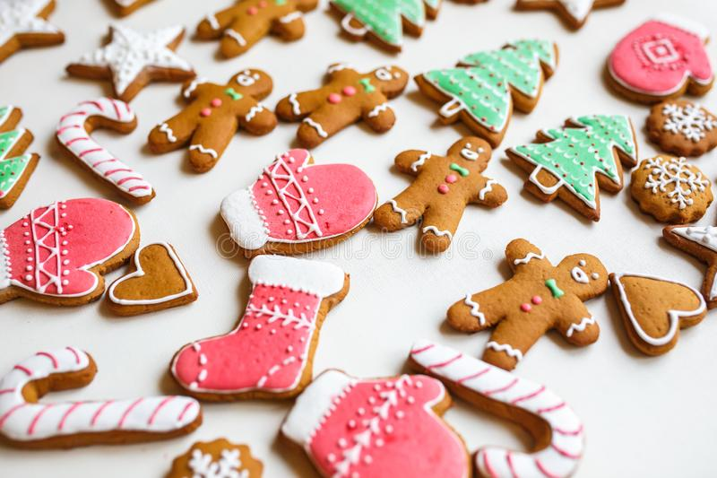 Handmade festive gingerbread cookies in the form of stars, snowflakes, people, socks, staff, mittens, Christmas trees, hearts for. Xmas and new year holiday on royalty free stock image