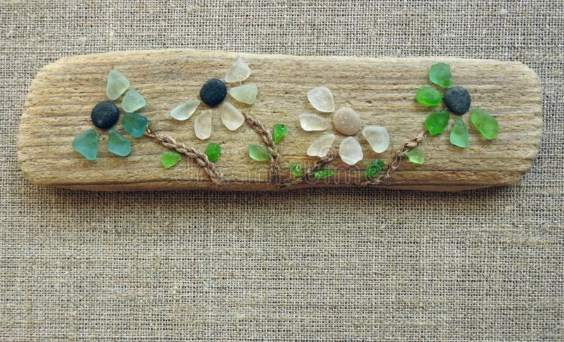 Handmade flowers picture using sea wood and glass, Lithuania stock photo