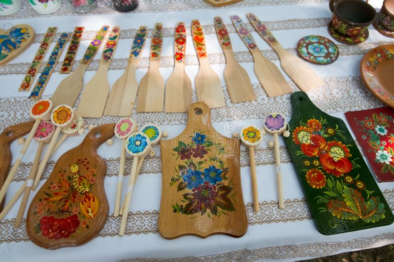 Handmade folklore wooden kitchen goods, spades and boards, sale exposition, traditional art royalty free stock photo