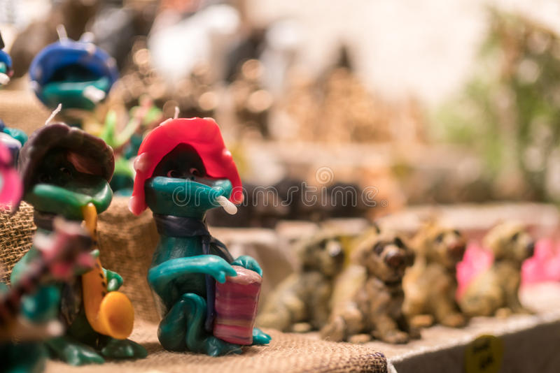 Handmade frog figures at busy Breitscheidplatz Christmas market. BERLIN, GERMANY - DECEMBER 1 2016: A busy Christmas market at night in Breitscheidplatz prior to royalty free stock image