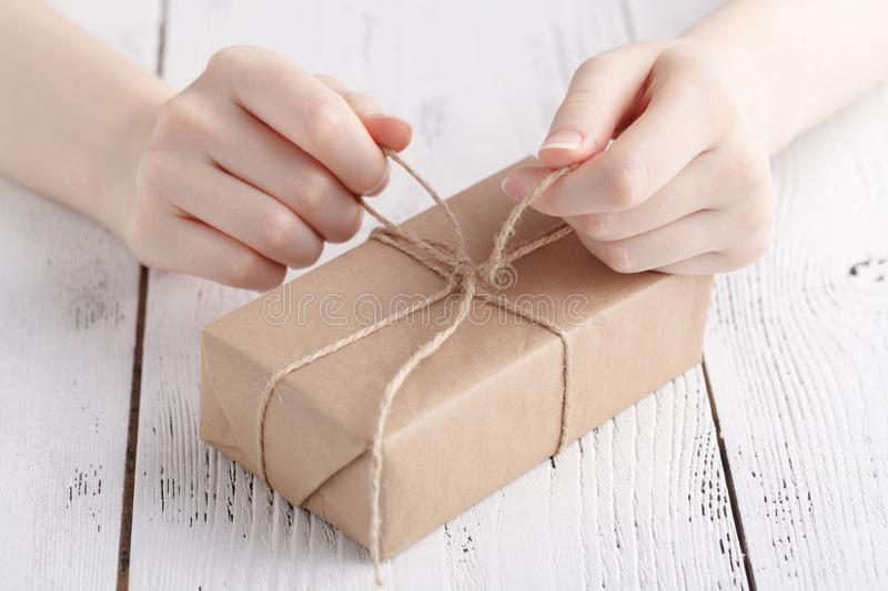 Handmade gift pcking in craft papper by female royalty free stock image