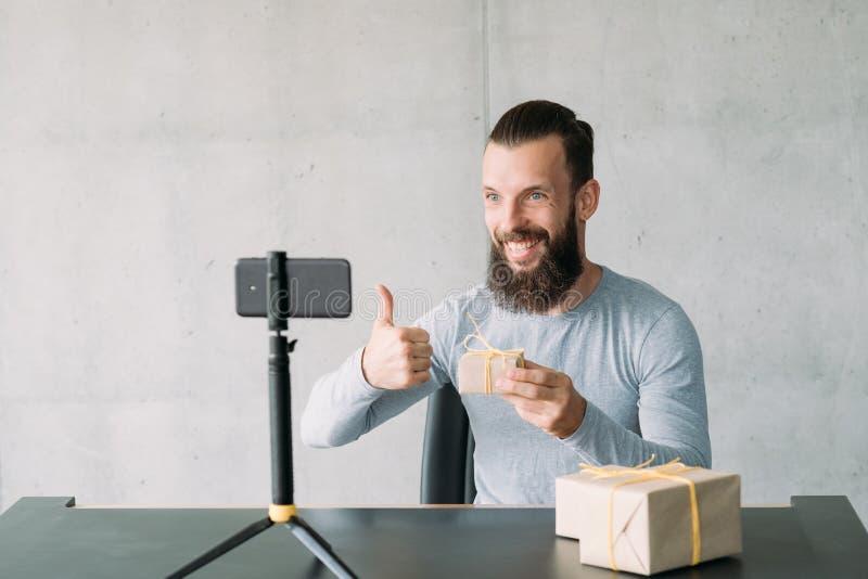 Handmade gift video guidance guy smartphone goods royalty free stock photography
