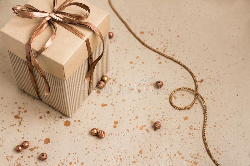Handmade gifts wrapped in paper paper with a bronze ribbon stock photography