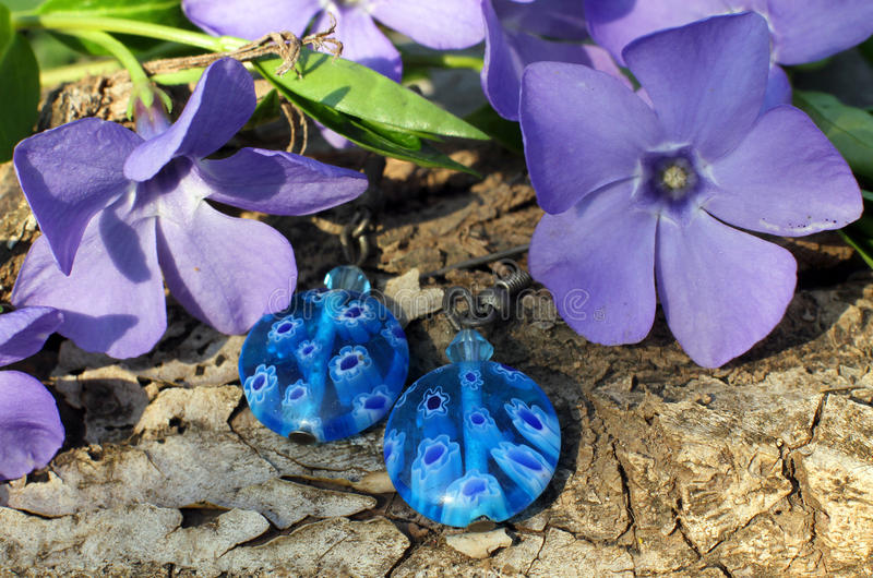Handmade glass earrings on the nature background stock photos
