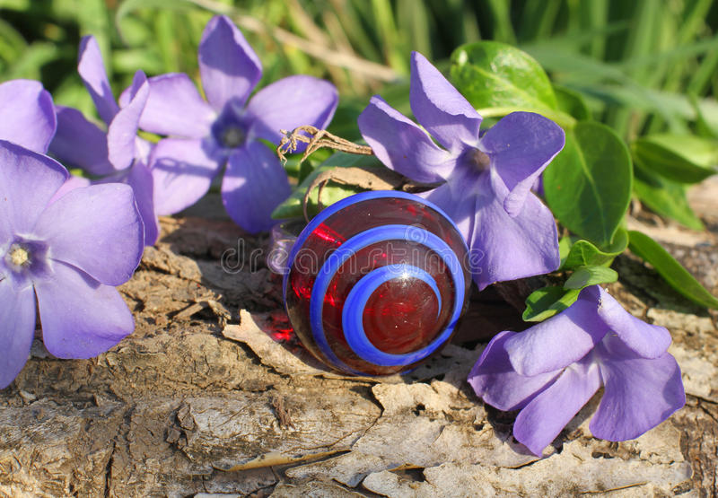 A Handmade glass ring on the nature background stock image