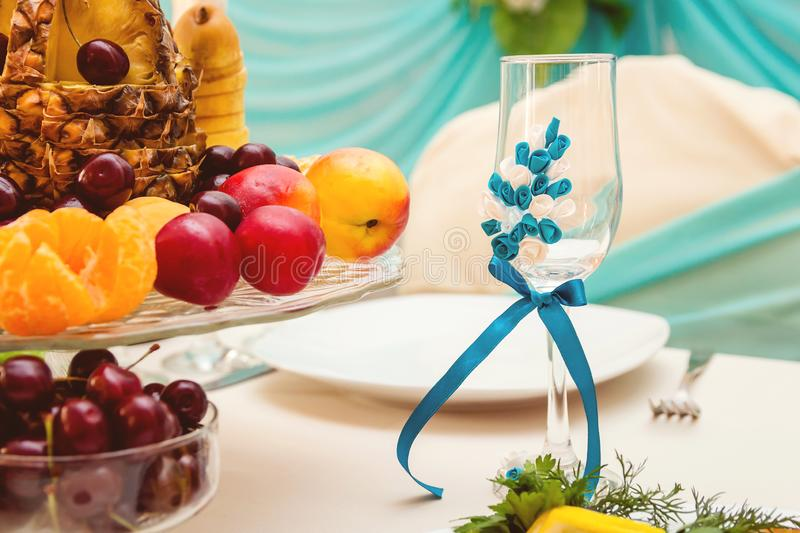 Handmade glass. wedding Banquet, fruit on the table. Decorated glass on the feast. wedding Banquet, fruit on the table stock images