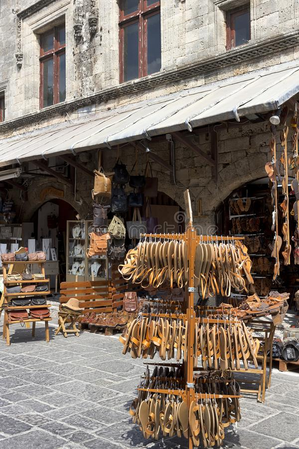 Handmade greek leather sandals and bags outside of a shop in street of Rhodes Old City, Greece royalty free stock photos