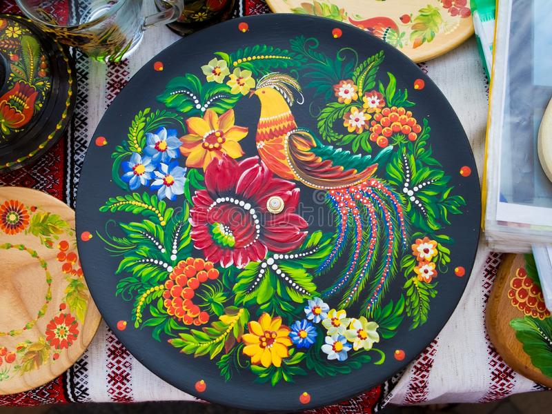 Handmade and handpainted decorative ceramic plate, bright floral patterns and fantastic bird, Petrykivka painting style stock photography