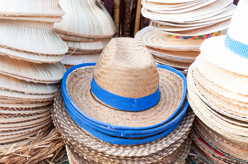 Handmade hats woven from bamboo hats arrangement on market stock images