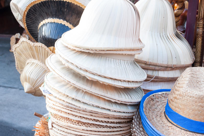 Handmade hats woven from bamboo hats arrangement on market royalty free stock photography