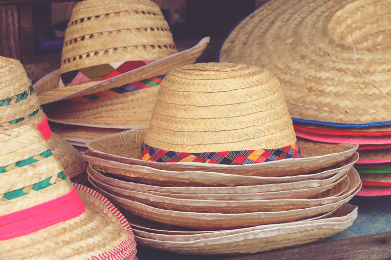 Handmade hats woven from bamboo on sale at market stock image
