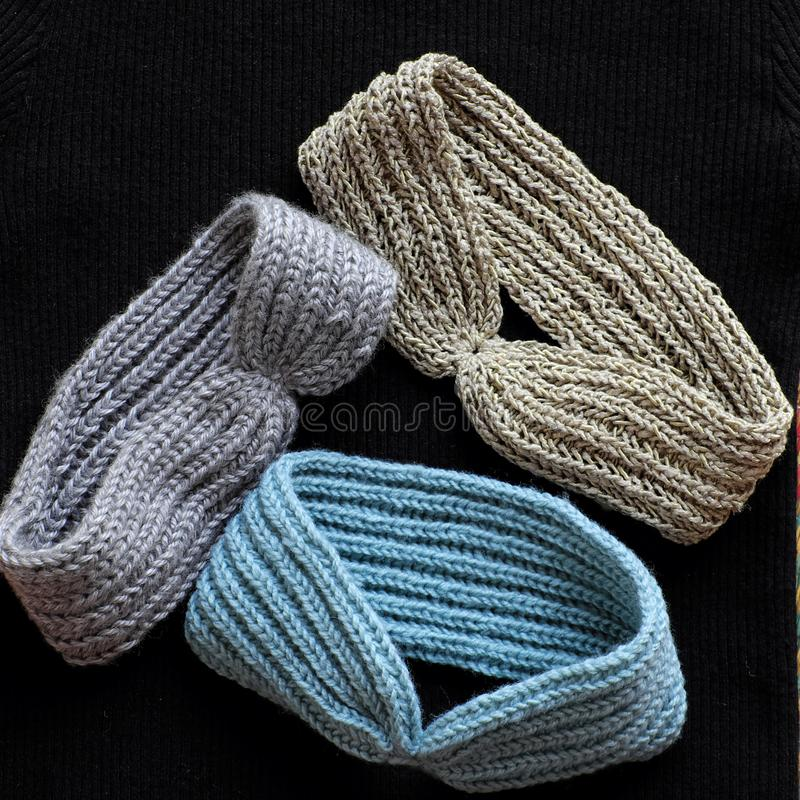 Handmade head bands knit in free time, accessories for woman. Group of handmade head bands knit in free time as leisure activity at home, accessories for woman royalty free stock photos