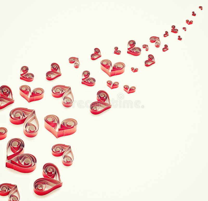 Handmade hearts cut from red paper royalty free stock photography