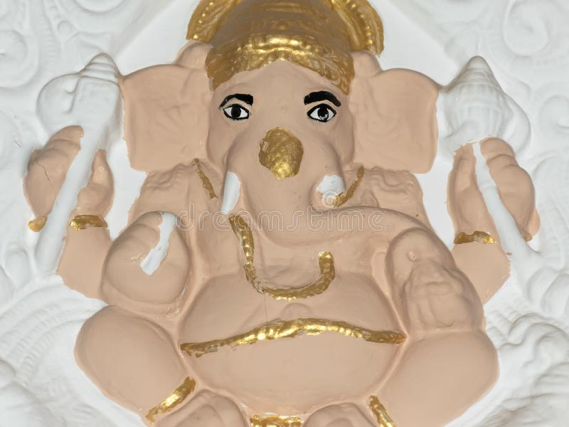 Handmade Hindu Lord Ganesh. Close up. Crafted Clay Model of Ganesha Statue depicts a calm and composed posture of the lord. A DIY stock photography