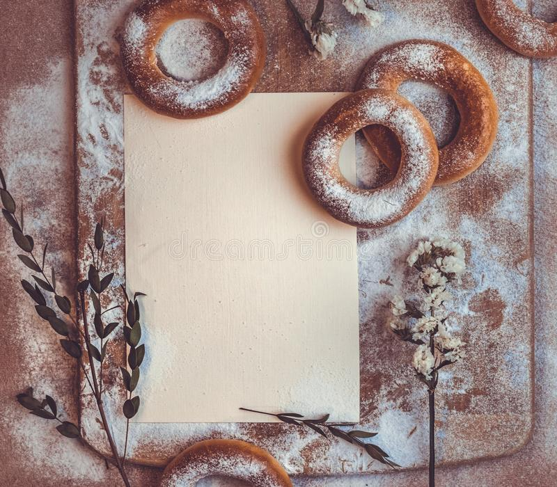 Handmade homemade bagel. Fresh pastries with sugar. Spring mood. Tasty background royalty free stock photo