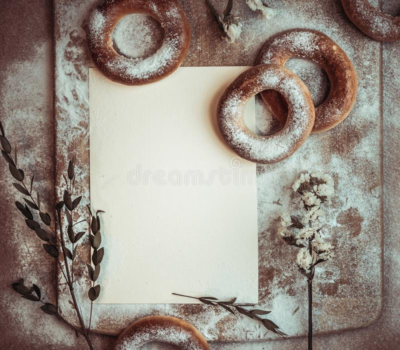 Handmade homemade bagel. Fresh pastries with sugar. Spring mood. Tasty background royalty free stock image