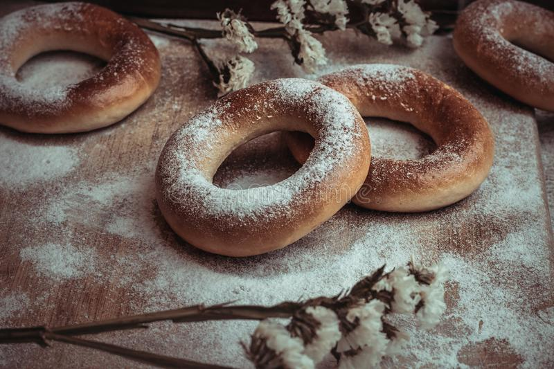 Handmade homemade bagel. Fresh pastries with sugar. Tasty background stock photos