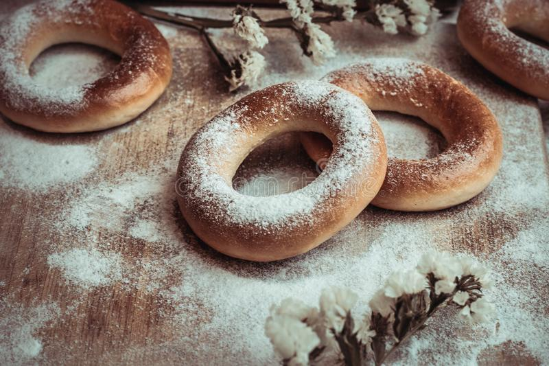 Handmade homemade bagel. Fresh pastries with sugar. Tasty background royalty free stock photography