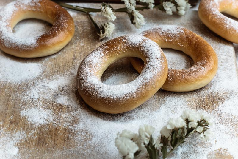 Handmade homemade bagel. Fresh pastries with sugar. Spring mood. Tasty background royalty free stock images