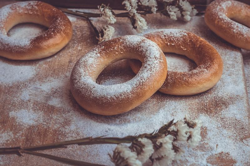 Handmade homemade bagel. Fresh pastries with sugar. Spring mood. Tasty background stock photos