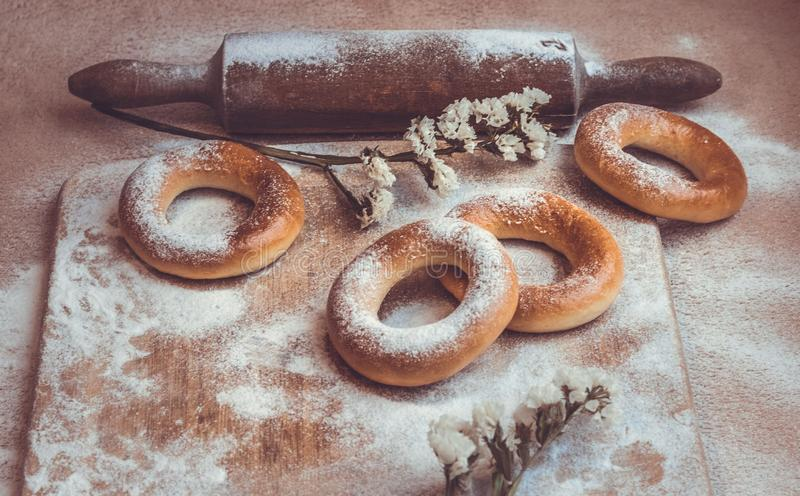 Handmade homemade bagel. Fresh pastries with sugar. Spring mood. Tasty background stock photography