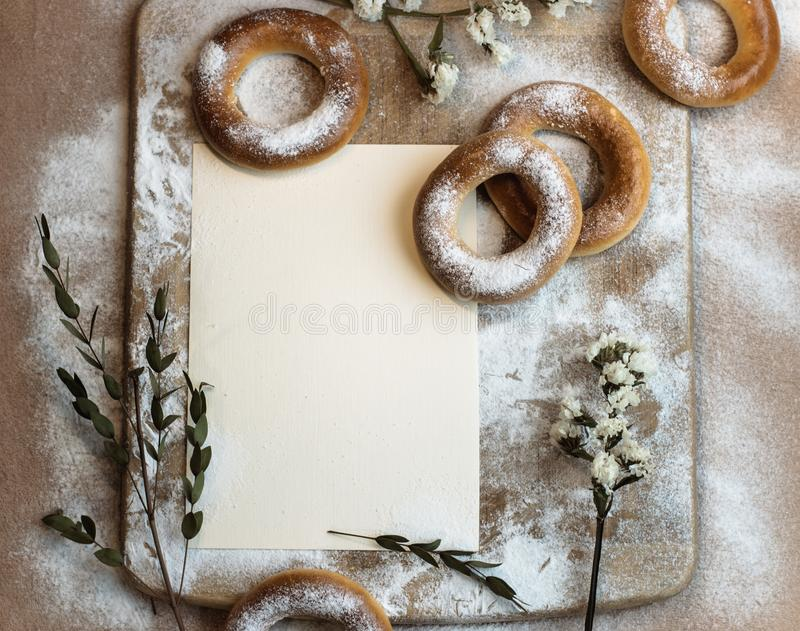 Handmade homemade bagel. Fresh pastries with sugar. Spring mood. Tasty background royalty free stock photography