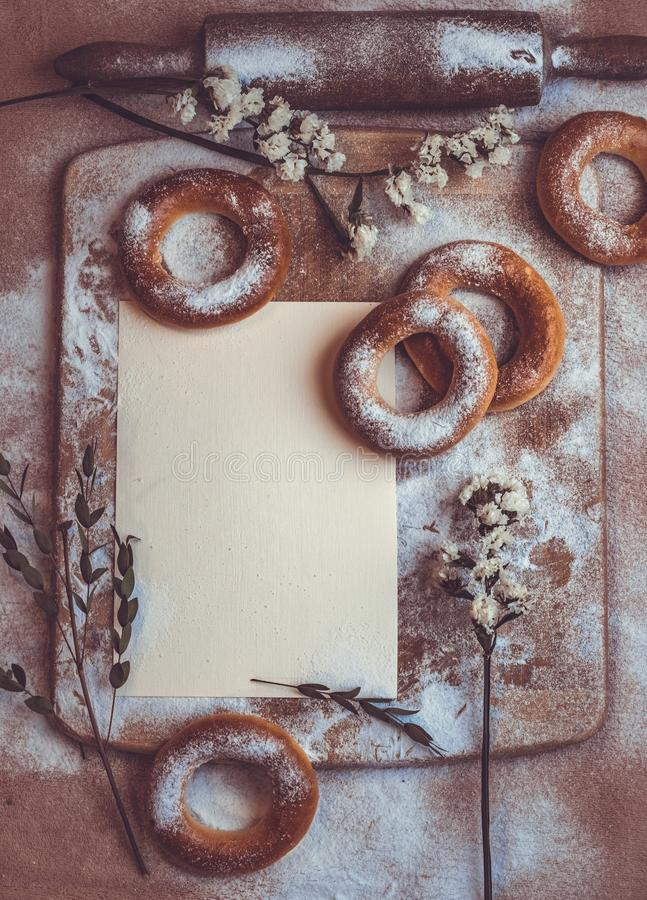 Handmade homemade bagel. Fresh pastries with sugar. Spring mood. Tasty background stock image