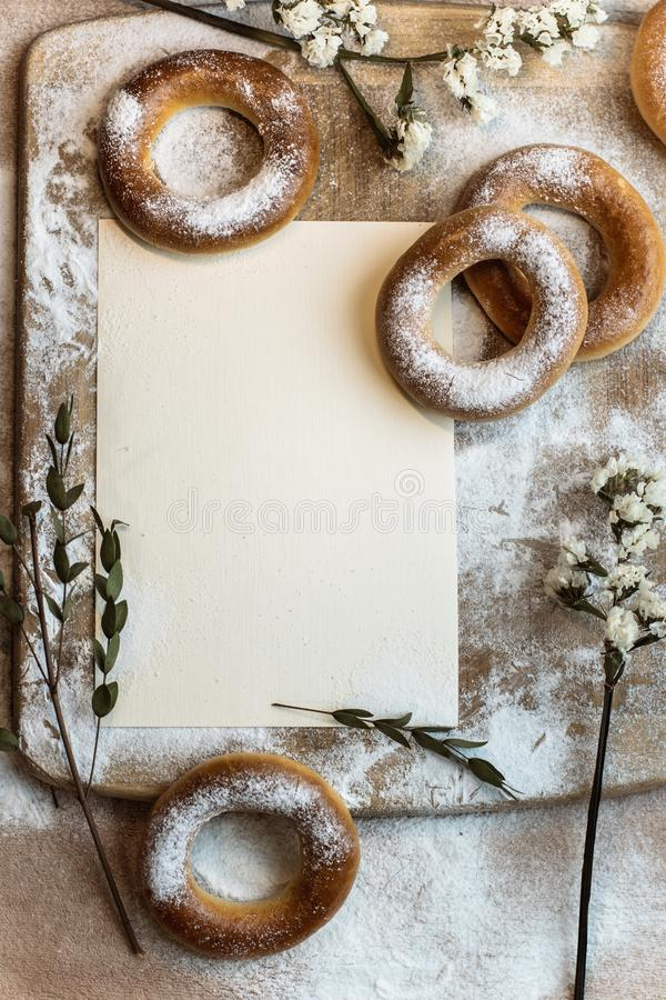 Handmade homemade bagel. Fresh pastries with sugar. Spring mood. Tasty background stock images