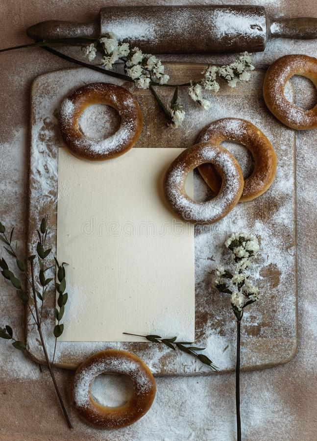 Handmade homemade bagel. Fresh pastries with sugar. Spring mood. Tasty background royalty free stock photos