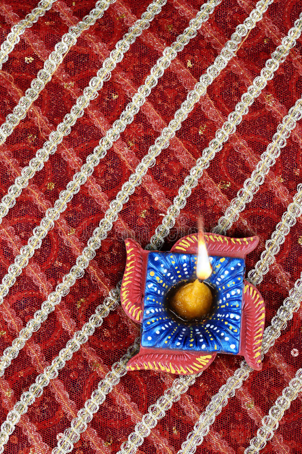 Handmade Indian Festive Lamp. Handmade Indian Diwali Diya in Swastik Shape royalty free stock photos