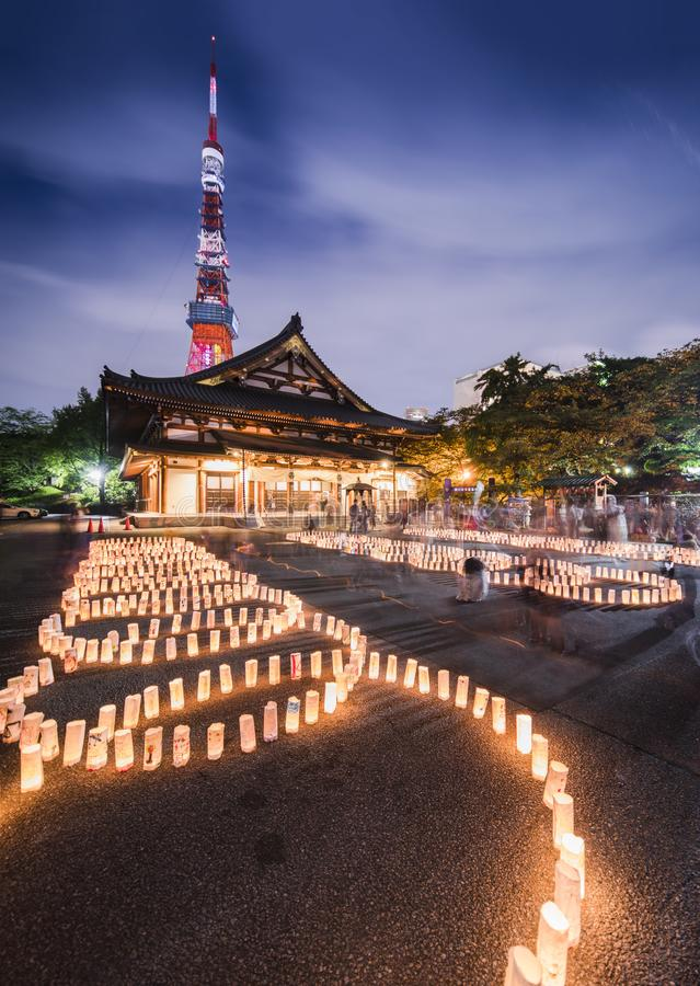 Handmade japanese washi paper lanterns aligned in circles illuminating the ground of the Zojoji temple near the Tokyo Tower royalty free stock images