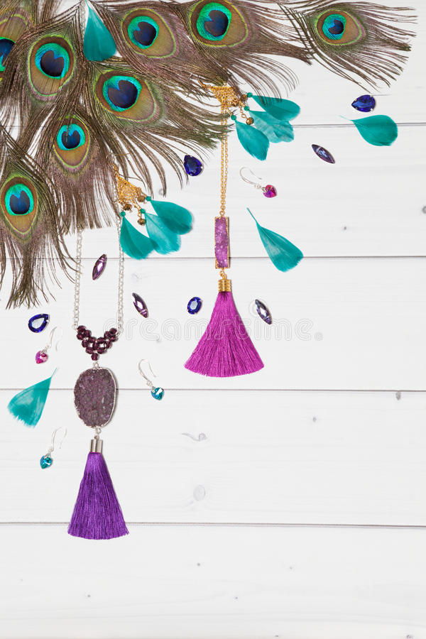 Handmade jewelry with gems,tassels and feathers stock photography