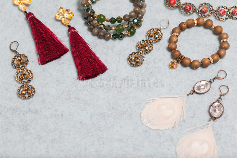 Handmade jewelry on the gray woolen background stock images