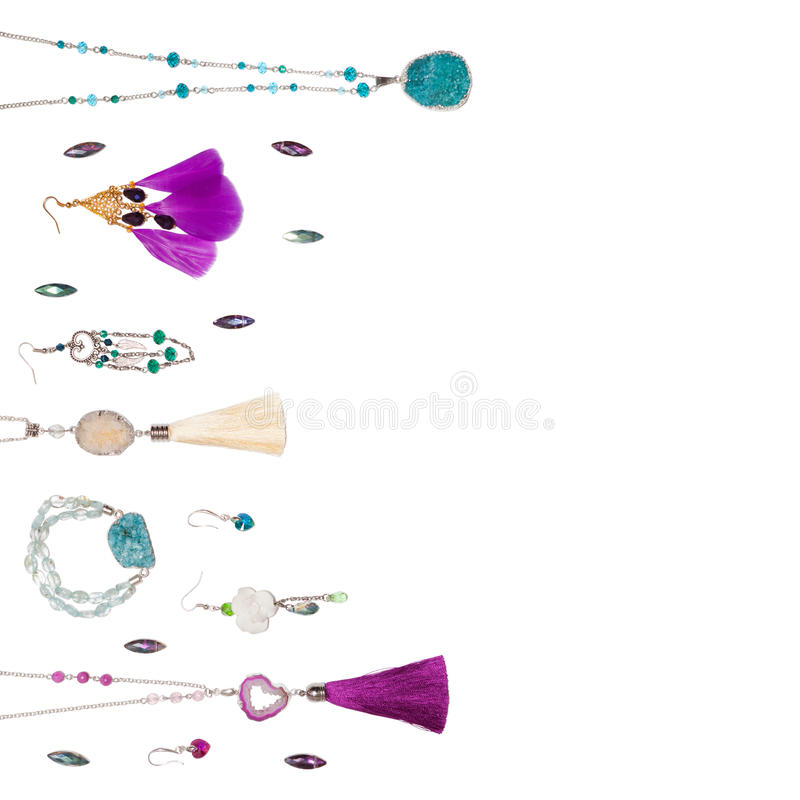 Handmade jewelry on the white square background royalty free stock photography