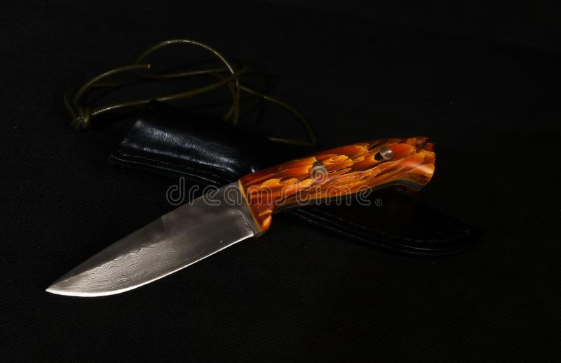 Handmade knife from damask steel. With the leather case and wooden hilt.Made by local cutler royalty free stock images