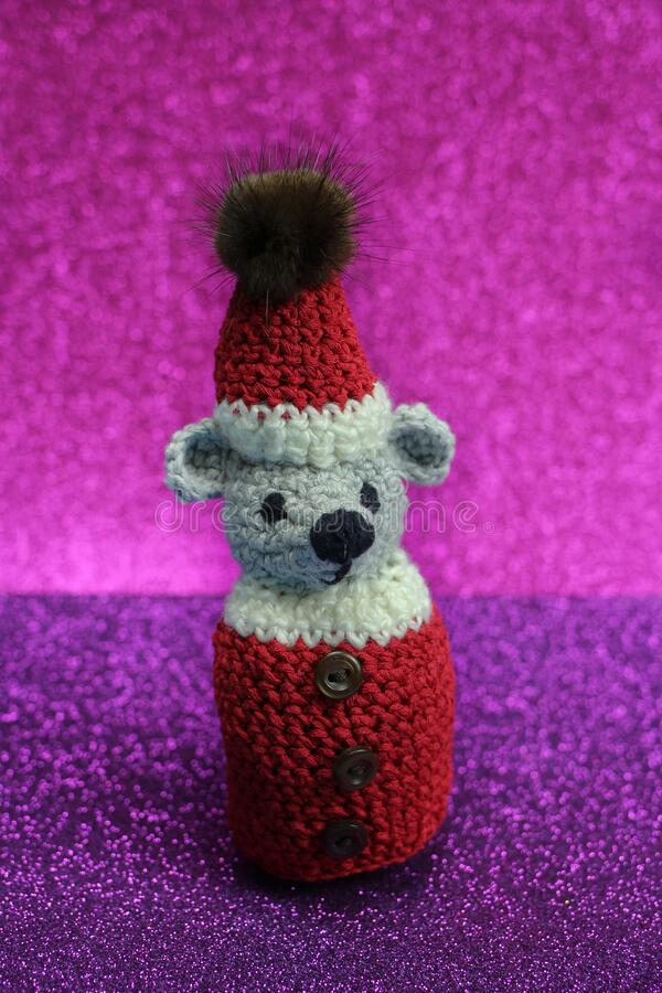 Handmade knitted Mouse on colored background . New Year symbol. Handmade knitted Mouse on colored background stock photos