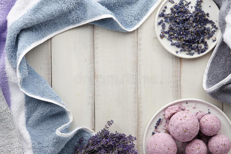 Handmade lavender bath bombs and flowers on white table royalty free stock images