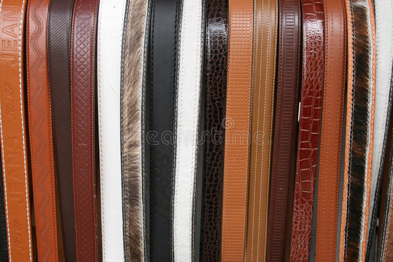 Handmade leather belts in Cotacachi. Handmade leather belts at the outdoor craft market in Cotacachi, Ecuador royalty free stock photo