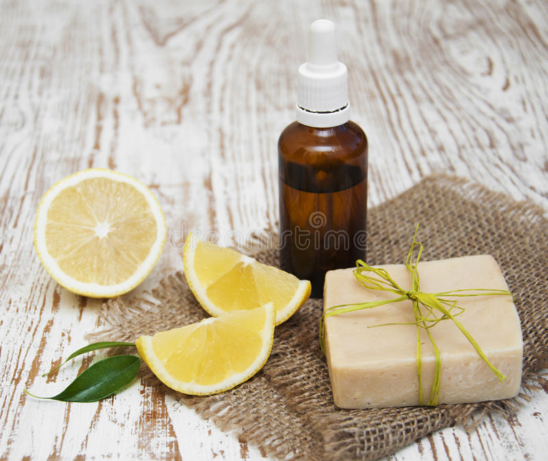 Handmade lemon soap and essential oil stock photography