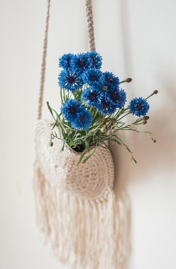 Handmade macrame bag with blue flowers royalty free stock photo
