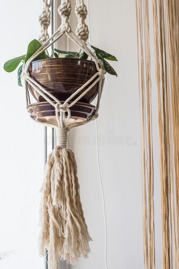 Handmade macrame for flowers in the interior of the concept royalty free stock photography